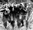 """ORG XMIT: *S0410003243* Wounded U.S. paratroopers are helped by fellow soldiers to a medical evacuation helicopter on Oct. 5, 1965 during the Vietnam War. Paratroopers of the 173rd Airborne Brigade's First Battalion suffered many casualties in the clash with Viet Cong guerrillas in the jungle of South Vietnam's """"D"""" Zone, 25 miles Northeast of Saigon. (AP Photo) 08292004xREADER 10152006xPOINTS 12092007xGUIDELIVE 09072008xGUIDELIVE"""
