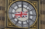 A British Union flag flutters in front of one of the clock faces of the 'Big Ben' clocktower of The Houses of Parliament in central London, Britain, February 22 , 2016. REUTERS/Toby Melville